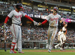 Washington Nationals' Trea Turner (7) is congratulated by Juan Soto, left, after scoring against the San Francisco Giants during the third inning of a baseball game Tuesday, Aug. 6, 2019, in San Francisco. (AP Photo/Ben Margot)