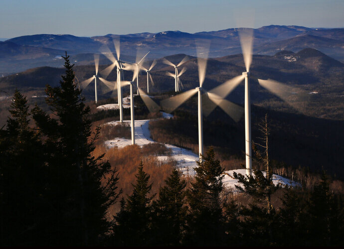 In this Tuesday, March 19, 2019 photo, the blades of wind turbines catch the breeze at the Saddleback Ridge wind farm in Carthage, Maine. The state's new Democratic Gov. Janet Mills has taken to show she would be more supported of green energy than former Republican Gov. Paul LePage, who lambasted wind power as a