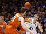 Duke's Jack White (41) and Miami's Sam Waardenburg (21) chase the ball during the first half of an NCAA college basketball game in Durham, N.C., Saturday, March 2, 2019. (AP Photo/Gerry Broome)