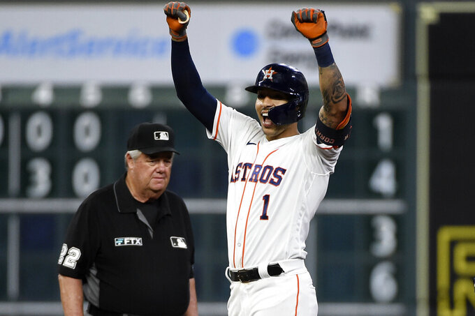 Houston Astros' Carlos Correa celebrates his double during the sixth inning of the team's baseball game against the Cleveland Indians, Tuesday, July 20, 2021, in Houston. (AP Photo/Eric Christian Smith)