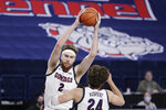 Gonzaga forward Drew Timme (2) grabs a rebound in front of forward Corey Kispert (24) during the first half of an NCAA college basketball game against Santa Clara in Spokane, Wash., Thursday, Feb. 25, 2021. (AP Photo/Young Kwak)