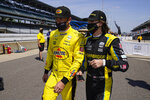 Scott McLaughlin, left, of New Zealand, and Colton Herta walk out of the pit area during practice for the Indianapolis 500 auto race at Indianapolis Motor Speedway in Indianapolis, Thursday, May 20, 2021. (AP Photo/Michael Conroy)