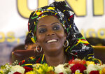 FILE - In this Dec. 16, 2016, file photo, Zimbabwean first lady Grace Mugabe attends a ruling ZANU PF Party Conference in Masvingo, Zimbabwe. Known as a strong-willed woman with political ambitions, Grace Mugabe rose from being one of the president's secretaries to become first lady. (AP Photo/Tsvangirayi Mukwazhi, File)