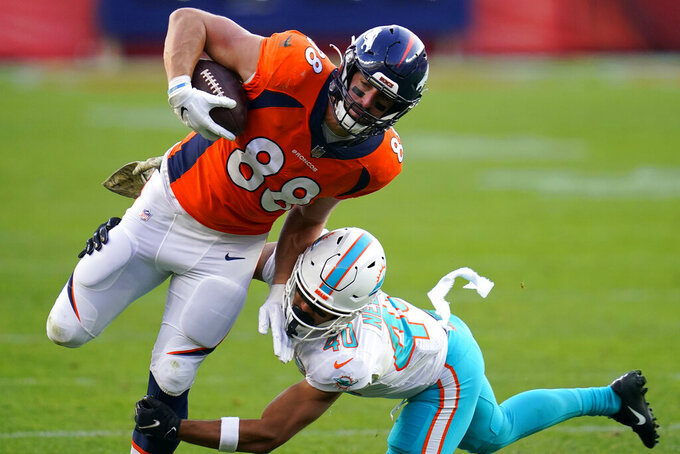 Denver Broncos tight end Nick Vannett (88) is hit by Miami Dolphins defensive back Nik Needham (40) during the second half of an NFL football game, Sunday, Nov. 22, 2020, in Denver. (AP Photo/David Zalubowski)