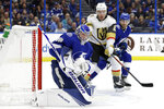 Tampa Bay Lightning goaltender Andrei Vasilevskiy (88) makes a blocker save as Vegas Golden Knights center Paul Stastny (26) looks for a rebound during the first period of an NHL hockey game Tuesday, Feb. 4, 2020, in Tampa, Fla. (AP Photo/Chris O'Meara)