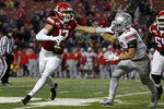 Rutgers quarterback Johnny Langan (17) scrambles away from Ohio State linebacker Cade Stover (16) during the second half of an NCAA college football game Saturday, Nov. 16, 2019, in Piscataway, N.J. Ohio State won 56-21. (AP Photo/Adam Hunger)