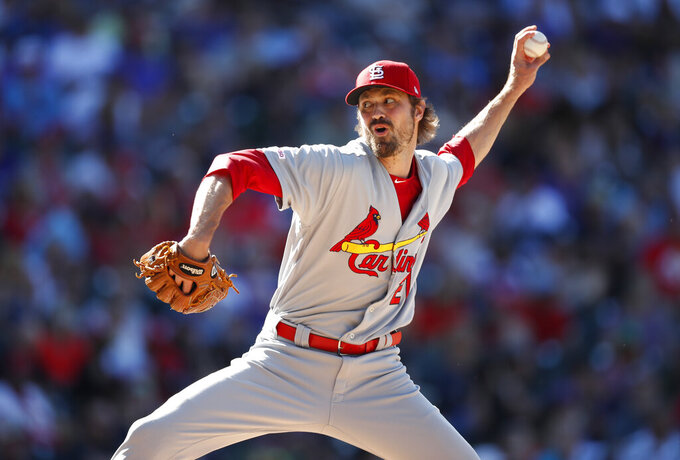 FILE - In this Sept. 12, 2019, file photo, St. Louis Cardinals relief pitcher Andrew Miller works against the Colorado Rockies during the seventh inning of a baseball game in Denver. Major League Baseball players are upset over the prospect teams may seek additional pay cuts if games are played in empty ballparks due to the coronavirus outbreak. There is little chance for a full 162-game schedule, and players stand to forfeit from $222,222 for each game missed to $3,478 for those at the $563,500 minimum. Miller, a member of the union's eight-man executive committee, would lose $70,988 per game of his $11.5 million salary. (AP Photo/David Zalubowski, File)