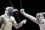 Luigi Samele of Italy, left, loses his saber as he competes against Kim Junhgwhan of South Korea in a men's individual semifinal Sabre competition at the 2020 Summer Olympics, Saturday, July 24, 2021, in Chiba, Japan. (AP Photo/Andrew Medichini)