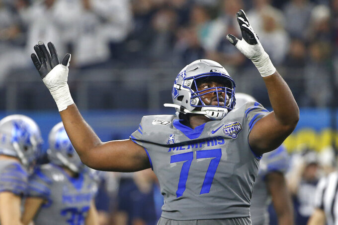 Memphis offensive lineman Obinna Eze (77) celebrates after Memphis kicked a field goal against Penn State in the first half of the NCAA Cotton Bowl college football game, Saturday, Dec. 28, 2019, in Arlington, Texas. (AP Photo/Ron Jenkins)