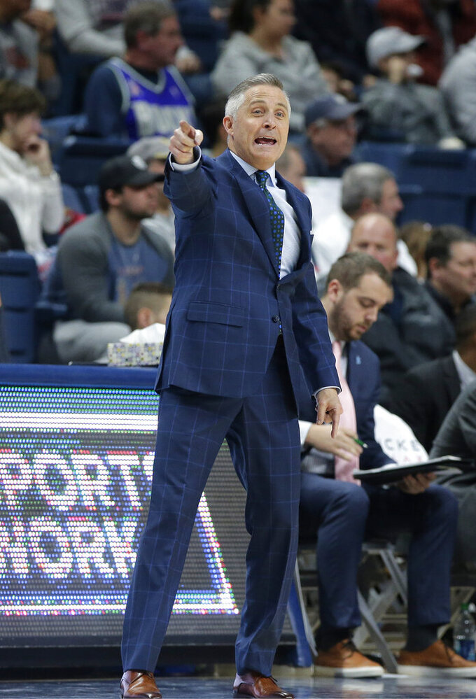 South Florida head coach Brian Gregory shouts from the bench during the second half of an NCAA college basketball game against Connecticut, Sunday, March 3, 2019, in Storrs, Conn. (AP Photo/Steven Senne)