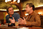 This image released by Sony Pictures shows Brad Pitt, left, and Leonardo DiCaprio in Quentin Tarantino's
