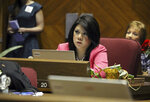 FILE - Republican Arizona state Sen. Kimberly Yee watches as the vote tally on a children's health insurance bill she opposed shows the measure passing on May 6, 2016, at the Capitol in Phoenix. Next year could be a pivotal one for women gubernatorial candidates. In Arizona, where Republican Gov. Doug Ducey can't run again, the field already has several candidates who are women, including State Treasurer Yee and Democratic Secretary of State Katie Hobbs. (AP Photo/Bob Christie, File)