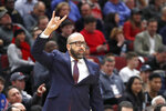 New York Knicks head coach David Fizdale signals a play during the first half of an NBA basketball game against the Chicago Bulls Tuesday, Nov. 12, 2019, in Chicago. (AP Photo/Charles Rex Arbogast)