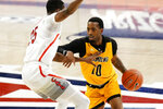 Grambling guard Trevell Cunningham, right, drives against Arizona center Christian Koloko (35) during the first half of an NCAA college basketball game Friday, Nov. 27, 2020, in Tucson, Ariz. (AP Photo/Rick Scuteri)