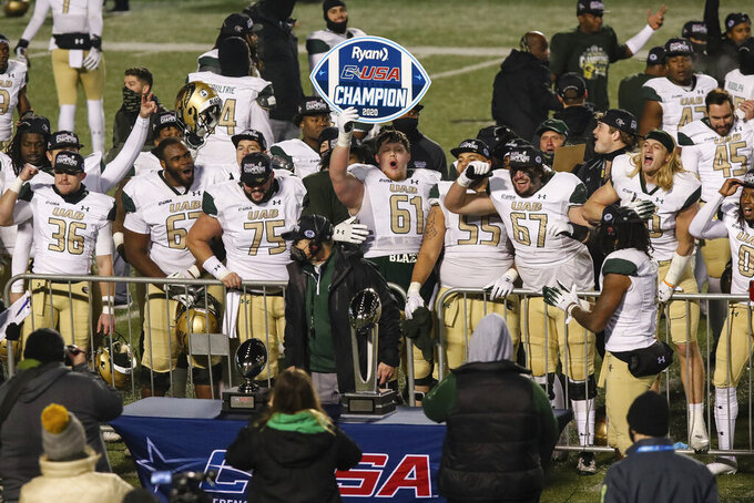 UAB players celebrate after defeating Marshall in an NCAA college football game for the Conference USA Football Championship on Friday, Dec. 18, 2020,  in Huntington, W.Va.  (Sholten Singer/The Herald-Dispatch via AP)