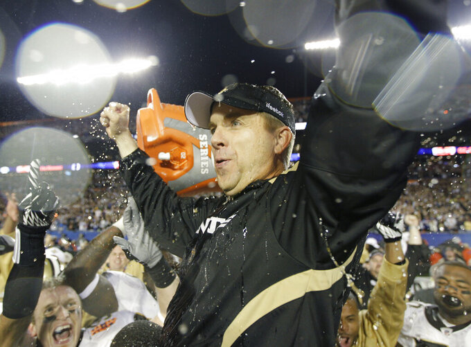 FILE - In this Feb. 7, 2010, file photo, New Orleans Saints head coach Sean Payton celebrates after the NFL Super Bowl XLIV football game against the Indianapolis Colts, in Miami. The Saints beat the Colts 31-17. As part of its celebration of its 100th season, the NFL is designating a Game of the Week, each chosen to highlight a classic matchup. For this week, it is the Colts-Saints game. (AP Photo/David J. Phillip, File)