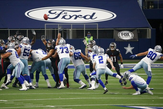 Dallas Cowboys kicker Greg Zuerlein (2) kicks a field goal in the closing seconds of an NFL football game against the Atlanta Falcons in Arlington, Texas, Sunday, Sept. 20, 2020. The Cowboys won 40-39. (AP Photo/Ron Jenkins)