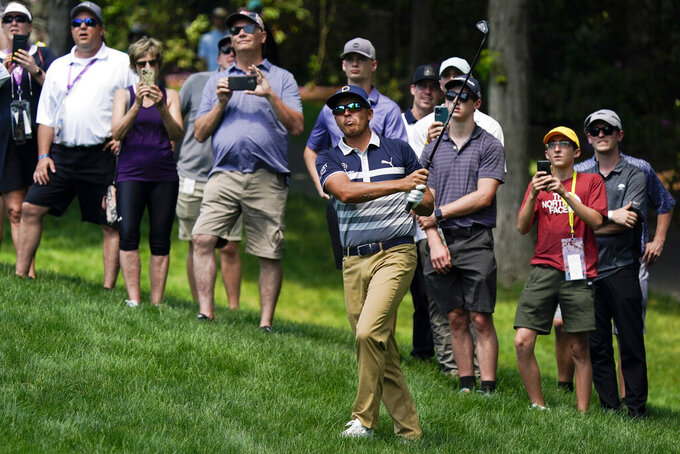 Rickie Fowler hits to the ninth green during the third round of the Memorial golf tournament, Saturday, June 5, 2021, in Dublin, Ohio. (AP Photo/Darron Cummings)
