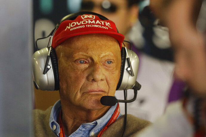 File - In this Friday, Nov. 10, 2017 file photo, former Austrian Formula One driver Niki Lauda stands in the Mercedes pit during the first free practice at the Interlagos race track in Sao Paulo, Brazil. The three-time Formula One world champion Niki Lauda has died at the age of 70. (AP Photo/Nelson Antoine)