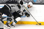 Los Angeles Kings defenseman Mikey Anderson, left, puts a hit on San Jose Sharks left wing Evander Kane during the second period of an NHL hockey game Saturday, April 3, 2021, in Los Angeles. (AP Photo/Mark J. Terrill)