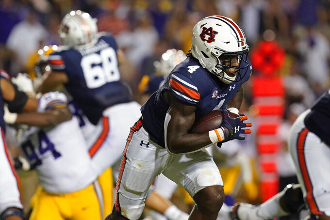 Auburn running back Tank Bigsby (4) carries in the first half of an NCAA college football game against LSU in Baton Rouge, La., Saturday, Oct. 2, 2021. (AP Photo/Gerald Herbert)