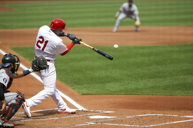 St. Louis Cardinals' Yadier Molina hits a two-run home run during the second inning in the first game of a baseball doubleheader against the Detroit Tigers Thursday, Sept. 10, 2020, in St. Louis. Molina is wearing the number 21 in honor of Roberto Clemente. (AP Photo/Scott Kane)
