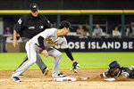 Chicago White Sox's Leury Garcia slides safely into second before the tag of Pittsburgh Pirates' Hoy Park for a double during the second inning of a baseball game as second base umpire Fieldin Culbreth watches Tuesday, Aug. 31, 2021, in Chicago. (AP Photo/Charles Rex Arbogast)