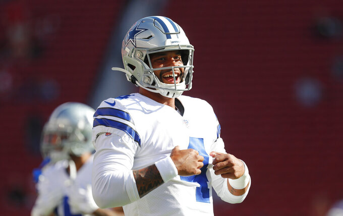 Dallas Cowboys quarterback Dak Prescott smiles while warming up before the team's NFL preseason football game against the San Francisco 49ers in Santa Clara, Calif., Saturday, Aug. 10, 2019. (AP Photo/Josie Lepe)