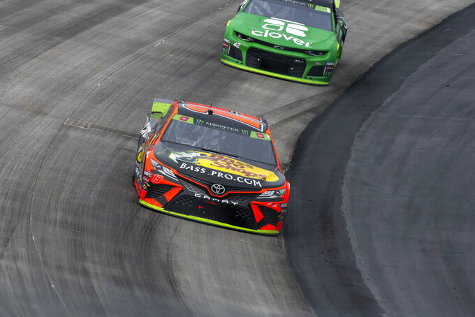 Martin Truex Jr. (19) competes at the Drydene 400 - Monster Energy NASCAR Cup Series playoff auto race, Sunday, Oct. 6, 2019, at Dover International Speedway in Dover, Del. (AP Photo/Jason Minto)