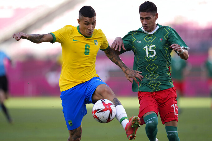 Brazil's Guilherme Arana (6) battles for the ball against Mexico's Uriel Antuna (15) during a men's soccer semifinal match at the 2020 Summer Olympics, Tuesday, Aug. 3, 2021, in Kashima, Japan. (AP Photo/Andre Penner)