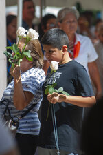 A fans waits in line outside of the Miami-Dade County Auditorium during a public funeral for the late singer Jose Jose, Sunday, October 6, 2019 in Miami. (AP Photo/Gaston De Cardenas)