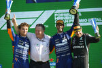 From left: Mclaren driver Lando Norris of Britain, Mclaren CEO Zak Brown, Mclaren driver Daniel Ricciardo of Australia and Mercedes driver Valtteri Bottas of Finland celebrate on the podium after the Italian Formula One Grand Prix, at Monza racetrack, in Monza, Italy, Sunday, Sept.12, 2021. (AP Photo/Luca Bruno)