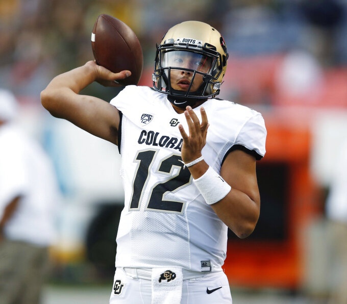 Colorado quarterback Steven Montez warms up before facing Colorado State in an NCAA college football game Friday, Aug. 31, 2018, in Denver. (AP Photo/David Zalubowski)