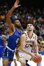Winthrop guard Chandler Vaudrin, right, posts up against Hampton guard Greg Heckstall during the first half of an NCAA college basketball game for the Big South tournament championship in Rock Hill, S.C., Sunday, March 8, 2020. (AP Photo/Nell Redmond)