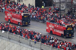 Busses carrying members of the Kansas City Chiefs travel in a parade through downtown Kansas City, Mo., Wednesday, Feb. 5, 2020, to celebrate the Chiefs victory in the NFL's Super Bowl 54. (AP Photo/Charlie Riedel)