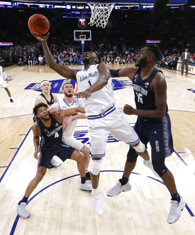 Seton Hall forward Michael Nzei (1) goes up for a shot against Georgetown center Jessie Govan (15) during the second half of an NCAA college basketball game in the Big East men's tournament, Thursday, March 14, 2019, in New York. Seton Hall won 73-57. (AP Photo/Julio Cortez)