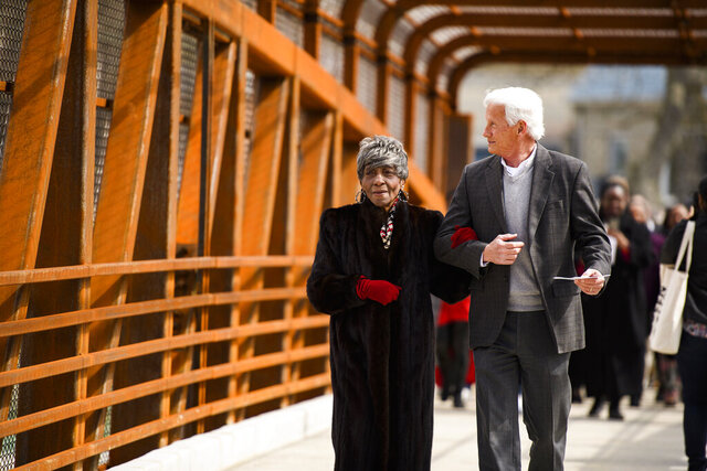 Greenville County councilwoman Xanthene Norris, left, walks across the Hampton Avenue Bridge for the first time with county administrator Joe Kernell during a dedication event Friday, March 6, 2020.  (Josh Morgan/The Independent-Mail via AP)