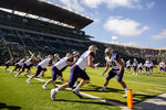 Washington players warm up before playing Oregon in an NCAA college football game in Eugene, Ore., Saturday, Oct. 13, 2018 (AP Photo/Thomas Boyd)
