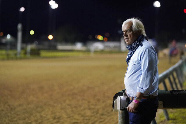 FILE - In this Sept. 4, 2020 file photo, trainer Bob Baffert watches at horses workout at Churchill Downs in Louisville, Ky. A filly trained by the two-time Triple Crown winner has tested positive in a post-race drug test for the second time this year, making it the third positive test by a horse in Baffert's stable in the last six months. Craig Robertson, Baffert's attorney, issued a statement confirming Gamine's test results after her third-place finish as the 7-10 favorite in the Kentucky Oaks at Churchill Downs on Sept. 4.  (AP Photo/Darron Cummings, File)