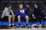 Dr. Rick Celebrini, left, Golden State Warriors Director of Sports Medicine and Performance, speaks with coach Steve Kerr, center, and general manager Bob Myers during practice for the NBA Finals against the Toronto Raptors Thursday, June 6, 2019, in Oakland, Calif. Game 4 of the NBA Finals is Friday in Oakland. (AP Photo/Ben Margot)