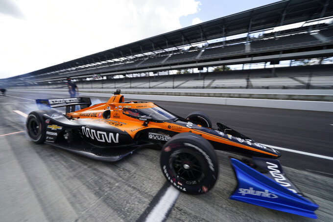 Helio Castroneves, of Brazil, pulls out of the pits during a practice session for an IndyCar auto race at Indianapolis Motor Speedway, Thursday, Oct. 1, 2020, in Indianapolis. (AP Photo/Darron Cummings)