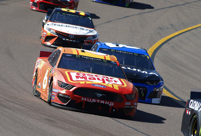 Ryan Newman (6) races Daniel Hemric (8) out of Turn 4 during the NASCAR Cup Series auto race at ISM Raceway, Sunday, March 10, 2019, in Avondale, Ariz. (AP Photo/Ralph Freso)