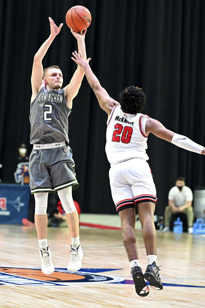UAB guard Michael Ertel (2) shoots over Western Kentucky guard Dayvion McKnight (20) in the second half of an NCAA college basketball game in the Conference USA men's tournament, in Frisco, Texas, Friday, March 12, 2021. Western Kentucky won 64-60. (AP Photo/Matt Strasen)