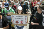 Algerian protesters gather during an anti-government demonstration in the centre of the capital Algiers, Algeria, Friday, June 7, 2019. Banner in Arabic reads