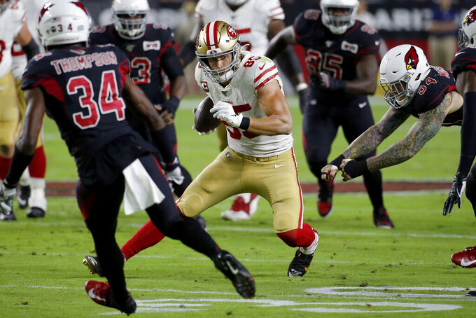 San Francisco 49ers tight end George Kittle (85) tries to avoid Arizona Cardinals defenders during the first half of an NFL football game, Thursday, Oct. 31, 2019, in Glendale, Ariz. (AP Photo/Rick Scuteri)