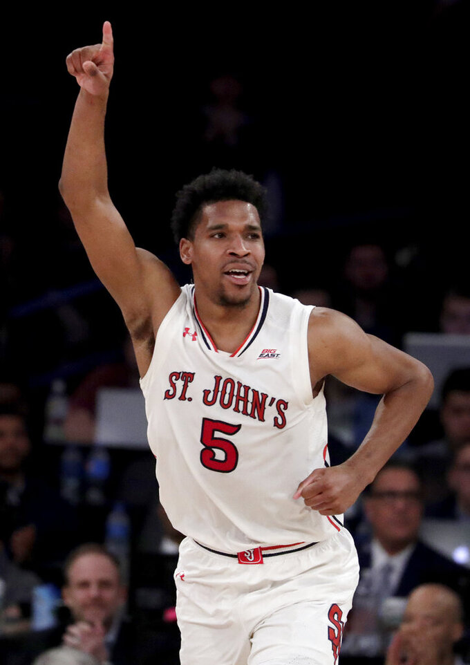 St. John's guard Justin Simon reacts after scoring a basket against DePaul during the second half of an NCAA college basketball game in the Big East men's tournament Wednesday, March 13, 2019, in New York. St. John's won 82-74. (AP Photo/Julio Cortez)
