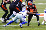 Cincinnati Bengals running back Samaje Perine (34) is tackled by Dallas Cowboys free safety Xavier Woods (25) in the first half of an NFL football game in Cincinnati, Sunday, Dec. 13, 2020. (AP Photo/Bryan Woolston)