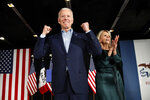 Democratic presidential candidate former Vice President Joe Biden at a caucus night campaign rally on Monday, Feb. 3, 2020, in Des Moines, Iowa with Jill Biden. (AP Photo/John Locher)