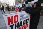 Anti-war activists stage a rally against the South Korean government's decision to send troops to Hormuz Strait, near the U.S. Embassy in Seoul, South Korea, Tuesday, Jan. 21, 2020. South Korean government on Tuesday said in a press release that the government had decided to send troops to Hormuz Strait to protect South Korean citizens and guarantee the freedom of navigation in the region. (AP Photo/Ahn Young-joon)
