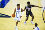 Creighton's Antwann Jones is defended by Omaha's Marlon Ruffin during the first half of an NCAA college basketball game in Omaha, Neb., Tuesday, Dec. 1, 2020. (AP Photo/Kayla Wolf)